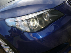 car-photo-2005-bmw-m5-passenger-headlight-close-up-interlagos-blue-metallic1
